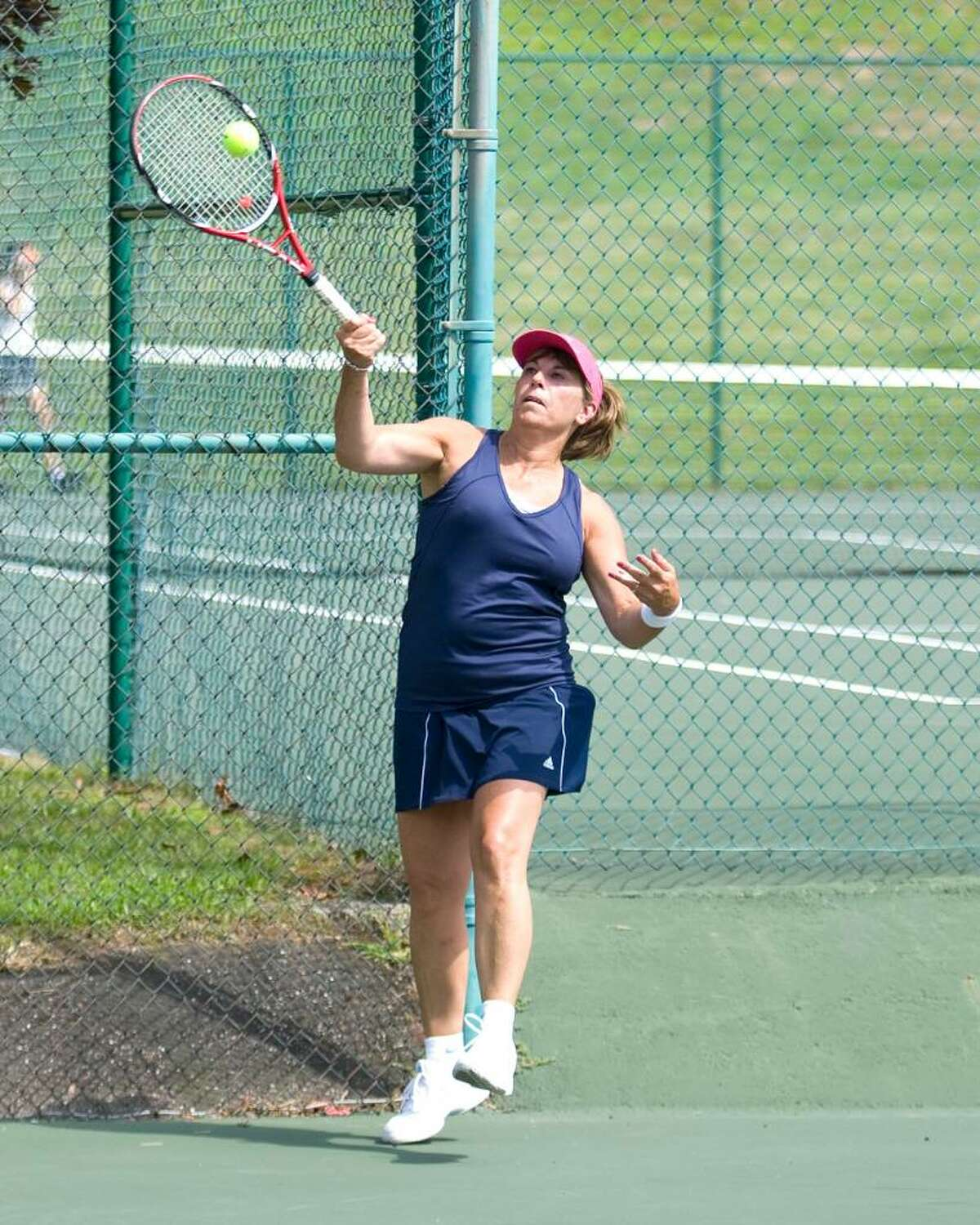 Sandra Atanasoff of Danbury hits a forehand return in her match against Cecily Koss of Southport during first round play in the Danbury Open Tennis Tournament Saturday at Wooster School in Danbury.
