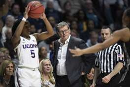 UConn coach Geno Auriemma watches play during the second half of the American Athletic Conference women's tournament finals against UCF.