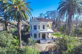 Own a historic farmhouse on 2+ acres of orchard in Sacramento-- or an 877 square foot condo in SF-- for $1.2M