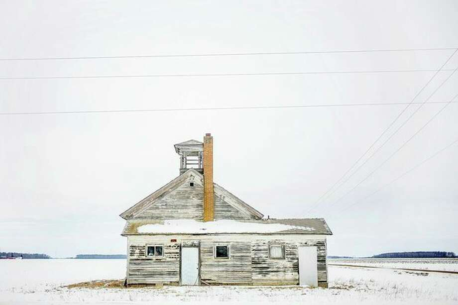 Snow covers the roof of an old one-room schoolhouse, formerly known as the Frost School, which remains at the corner of Barry and St. Charles Roads in Lafayette Township in northern Gratiot County. (Katy Kildee/kkildee@mdn.net)