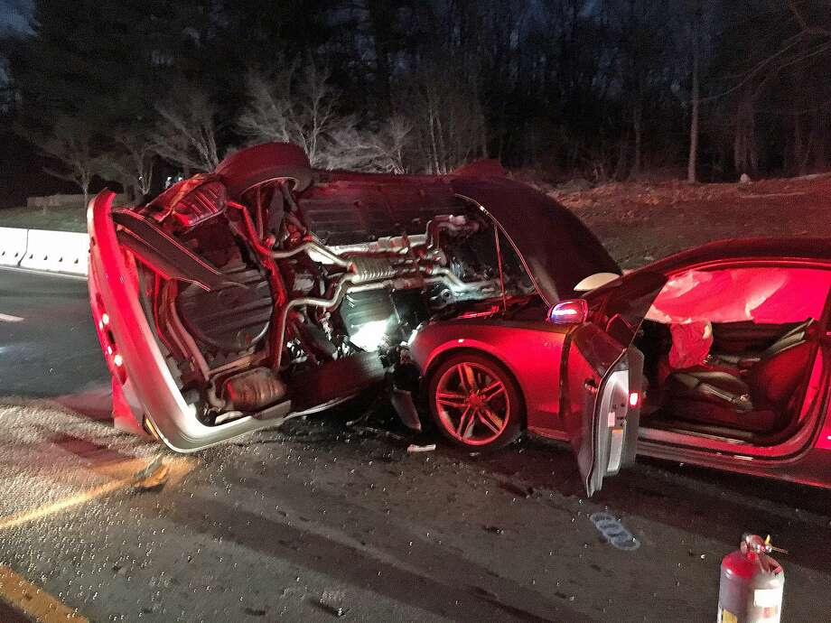 """The southbound Merritt Parkway was closed for more than two hours on Monday, March 11, 2019 in Westport because of after a two-car accident. The Westport Fire Department got the call at 7:27 p.m. of a motor-vehicle accident with one vehicles rolled over on its side. """"There were no injuries and the driver of the car on its side was able to climb out of the sun roof,"""" according to a Westport Fire Department release. Photo: Westport Fire Department Photo"""