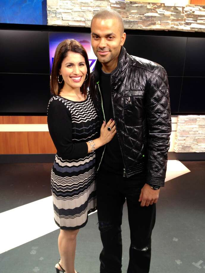 Former San Antonio Spur Tony Parker poses with Taylor for a picture after an interview. Photo: Monica Taylor