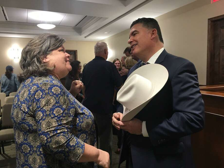 After the Katy City Council meeting came to a close on March 11,Noe Diaz Jr. who had just been named police chief, met with people who attended the session at Katy City Hall. Photo: Karen Zurawski / Karen Zurawski