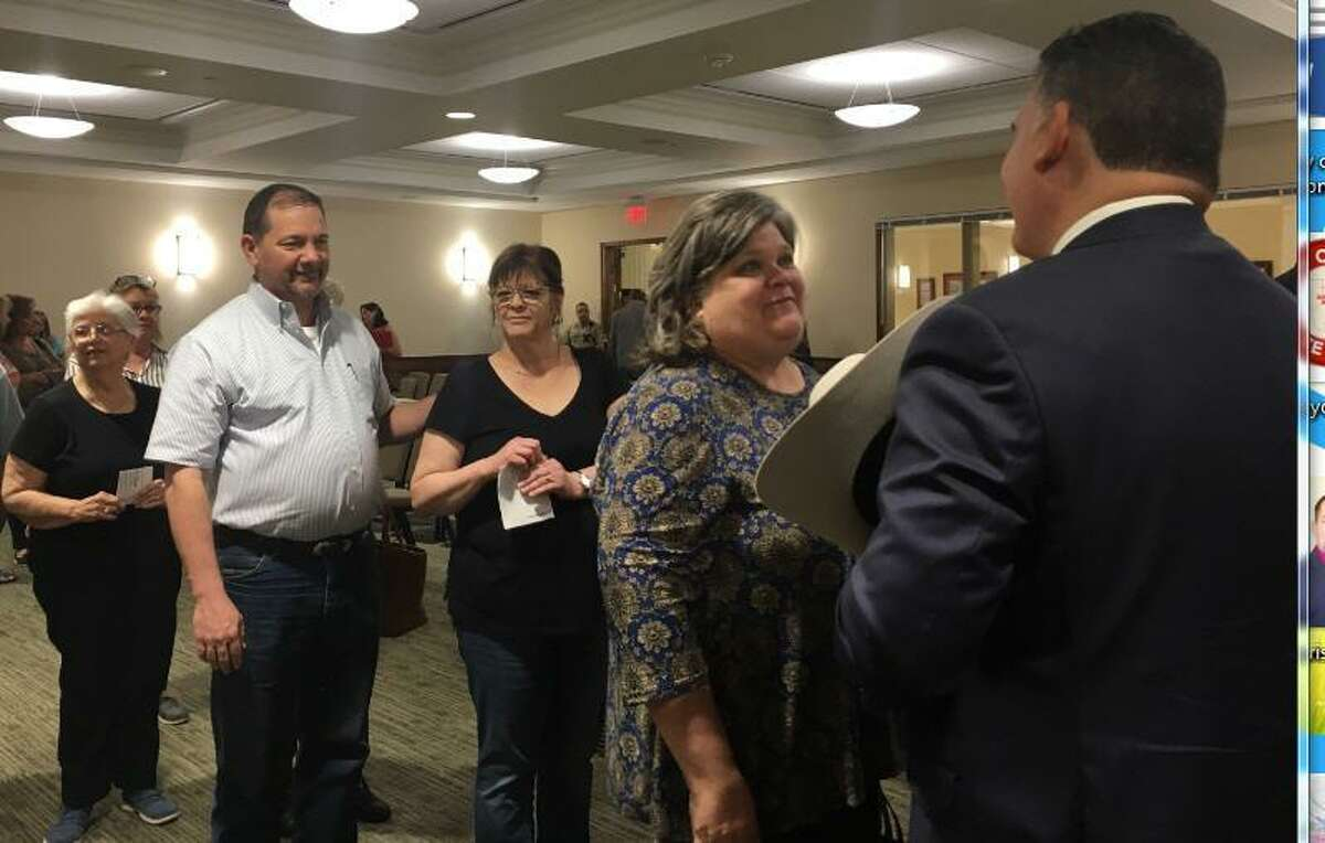 People lined up after the March 11 Katy City Council meeting to meet Noe Diaz Jr., who had just been appointed police chief.