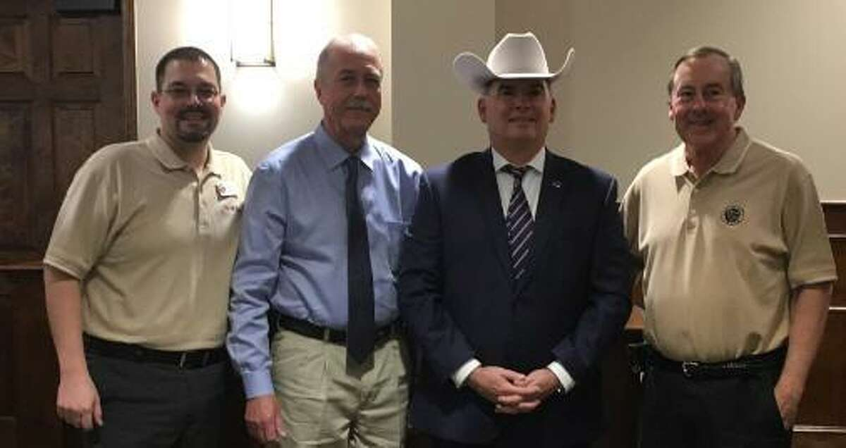 Officials celebrated the appointment of a new police chief, Noe Diaz, on Monday after the March 11 Katy City Council meeting. From left  Chris Harris, Councilman-at-large, Bill Hastings, who had served as police chief the last 10 years of his 32-year career with the Katy Police Department; Diaz and Katy Mayor Chuck Brawner.