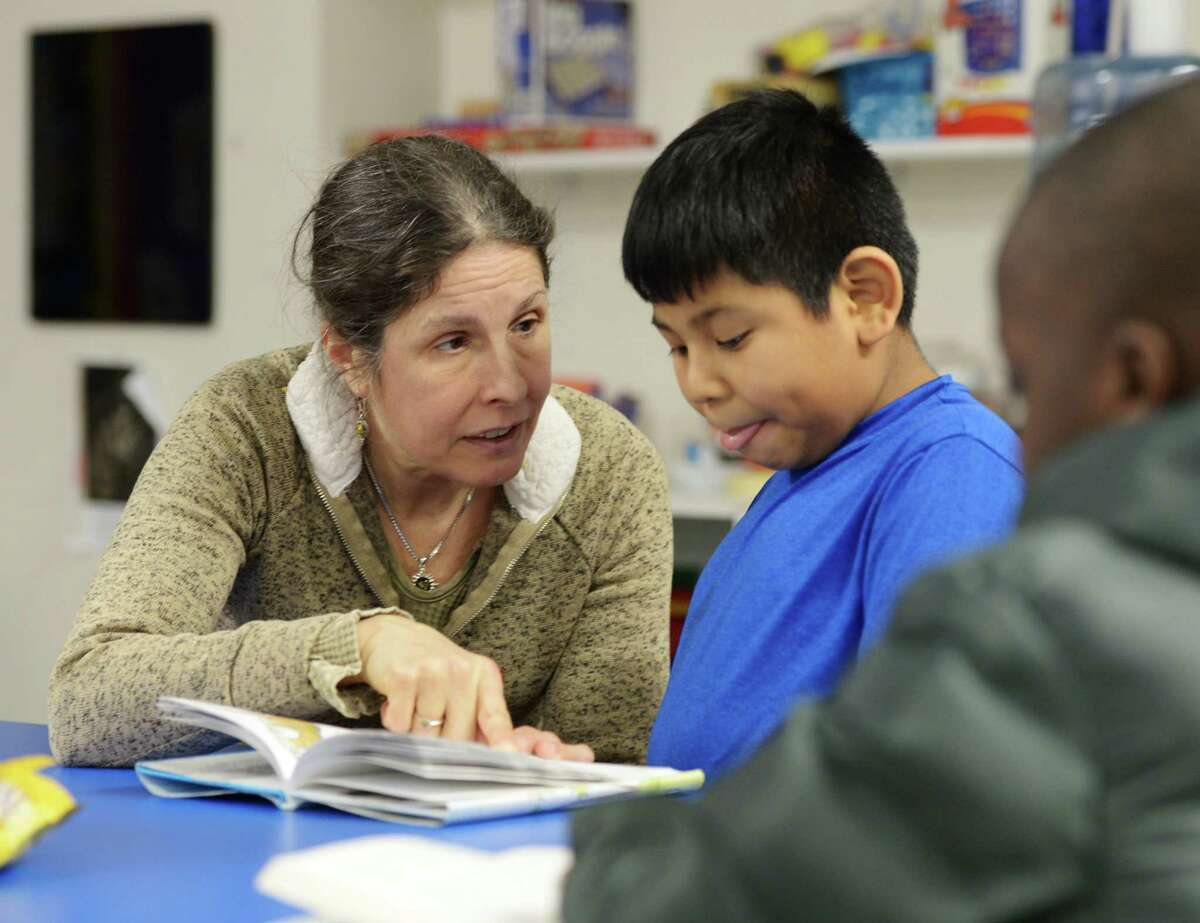 Tutor Janet Moody works with Josue Segovia, 8, at Family Centers' Family First in Education program at the YMCA Early Learning Center in Greenwich, Conn., on Tuesday, Jan. 29, 2019. Family Centers received a $75,000 grant to support school-based health centers.
