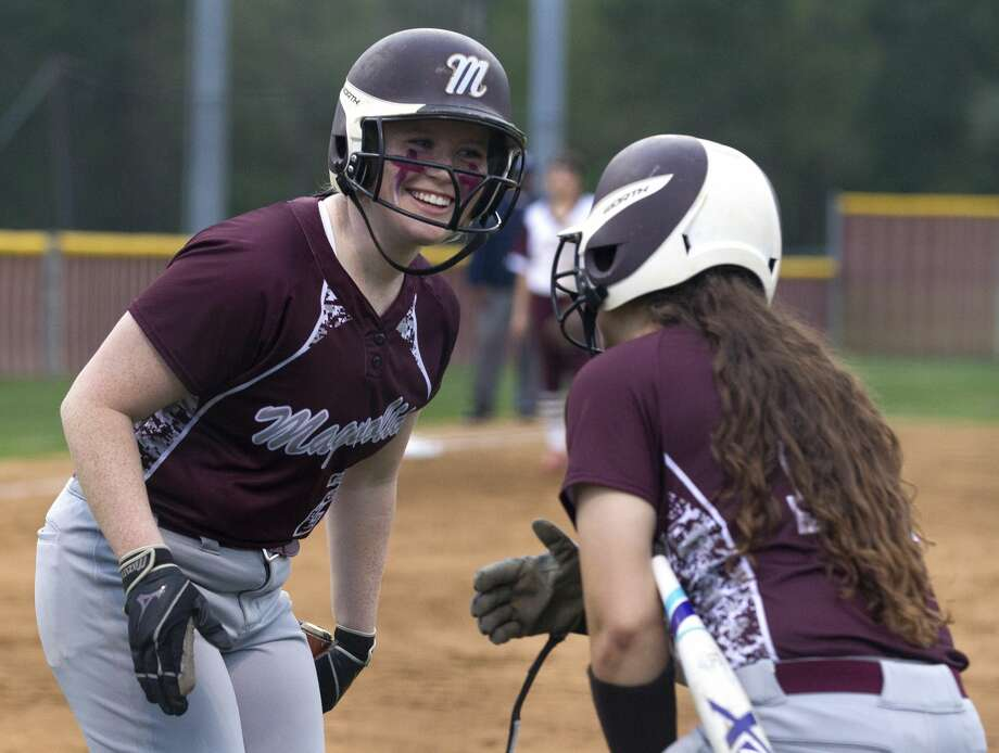 third baseman Reagan Creed #20 of Magnolia reacts after scoring on an error by Magnolia West first baseman Blair Rucker during the fourth inning of a District 19-5A high school softball game at Magnolia West High School, Monday, March 11, 2019, in Magnolia. Photo: Jason Fochtman/Staff Photographer