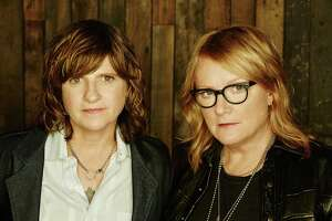 The Indigo Girls, Amy Ray, left, and Emily Saliers, perform at The Warner Theatre in Torrington on March 23.