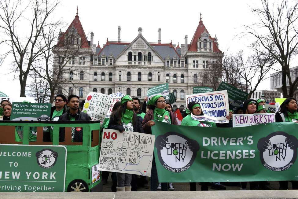 Protesters with the Green Light Campaign to get driver licenses for undocumented immigrants, take part in a rally in West Capitol Park on Tuesday, March 12, 2019, in Albany, N.Y. New York currently bars immigrants from obtaining a license due to their immigration status. (Will Waldron/Times Union)