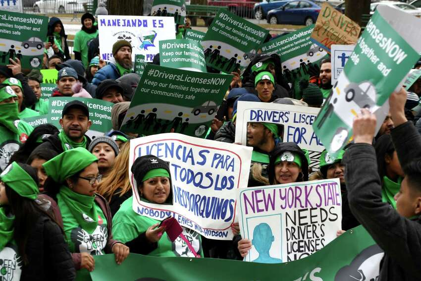 Protesters with the Green Light Campaign to get driver licenses for undocumented immigrants, rally in West Capitol Park on Tuesday, March 12, 2019, in Albany, N.Y. New York currently bars immigrants from obtaining a license due to their immigration status. (Will Waldron/Times Union)