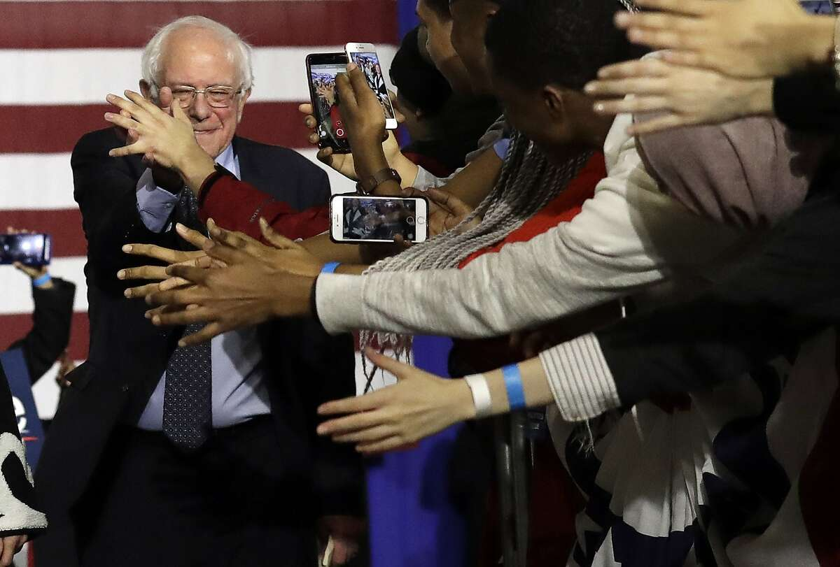 Sen. Bernie Sanders, I-Vt., left, greets to supporters as they arrive arrive for Bernie Sanders' 2020 presidential campaign at Navy Pier in Chicago, Sunday, March 3, 2019. Over the next several weeks, Sanders will travel to Iowa, New Hampshire, South Carolina, Nevada, and California. He will then return to Burlington, Vermont, for the official launch of his campaign. (AP Photo/Nam Y. Huh)
