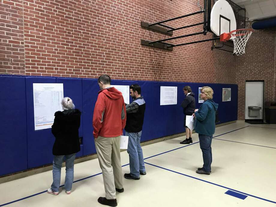 Cromwell residents review copies of documents related to the proposal for a new town garage on Monday, March 11, 2019. Photo: Jeff Mill / Hearst Connecticut Media