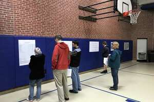 Cromwell residents review copies of documents related to the proposal for a new town garage on Monday, March 11, 2019.