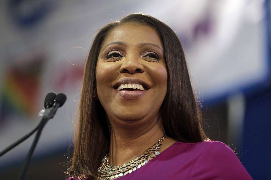 FILE - In this Jan. 6, 2019 file photo, Attorney General of New York, Letitia James, smiles during an inauguration ceremony in New York. James has opened a civil investigation into President Donald Trump's business dealings, taking action after his former lawyer told Congress he exaggerated his wealth to obtain loans. A person familiar with the inquiry said James issued subpoenas Monday, March 11, to Deutsche Bank and Investors Bank seeking records related to four Trump real estate projects and his failed 2014 bid to buy the NFL's Buffalo Bills.  (AP Photo/Seth Wenig, File) Photo: Seth Wenig, Associated Press