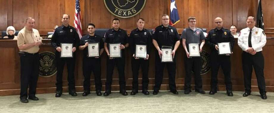"Saving the life of a three-year-old drowning victim on March 3 earned recognition for first responders from Katy Mayor Chuck Brawner and Fire Chief Russell Wilson at the March 11 Katy City Council meeting. Those honored are from Katy Fire Department Station No. 2, Quint 2 and Medic 2 and the Katy Police Department dispatch. Brawner read a proclamation honoring them for going ""above & beyond"" and Wilson presented each with a letter of commendation. From left are: Brawner, Harry Haynes, Rolando DeLeon, Julio Garcia, Michael Ondruch, Taylor Kunicki, Neil Lange and Trey Lee. Not pictured is Christian Kugler. Quint 2 members are Lee, Haynes, Garcia and De Leon. Medic 2 members are Ondruch and Kugler. Lange is the police dispatcher. Photo: Karen Zurawski / Karen Zurawski"