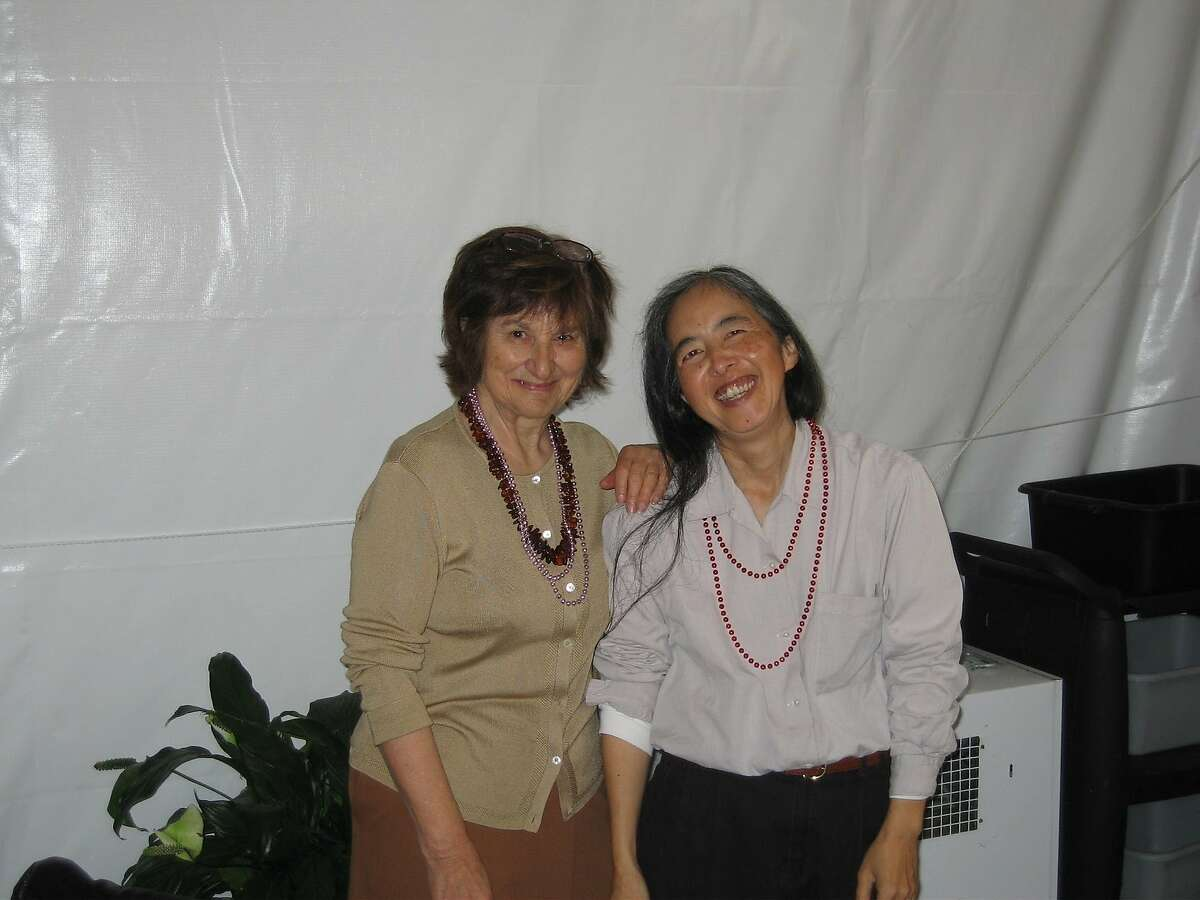 Janice Higashi (right) poses for a photo with retired San Francisco Chronicle reporter Marian Zaillian in 2007. Higashi died Sunday, five days after being struck by a car in San Francisco's Tenderloin neighborhood, her friends said.