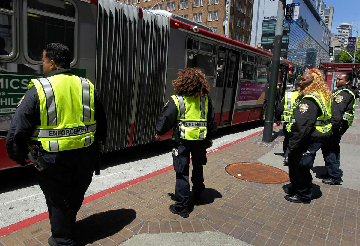 A team of Muni transit fare inspectors prepare to board a 14-Mission bus arriving at Fifth and Mission streets to check for fare evaders in San Francisco, Calif. on Tuesday, May 20, 2014. Many of the Clipper card fare readers aboard the buses are inoperable so some riders think they can ride for free.