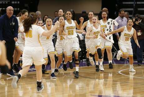 Menlo School players run on the court to celebrate their 70-63 win over Rolling Hills Prep in the CIF girls' Division II state high school basketball championship game, Saturday, March 9, 2019, in Sacramento, Calif. (AP Photo/Rich Pedroncelli)
