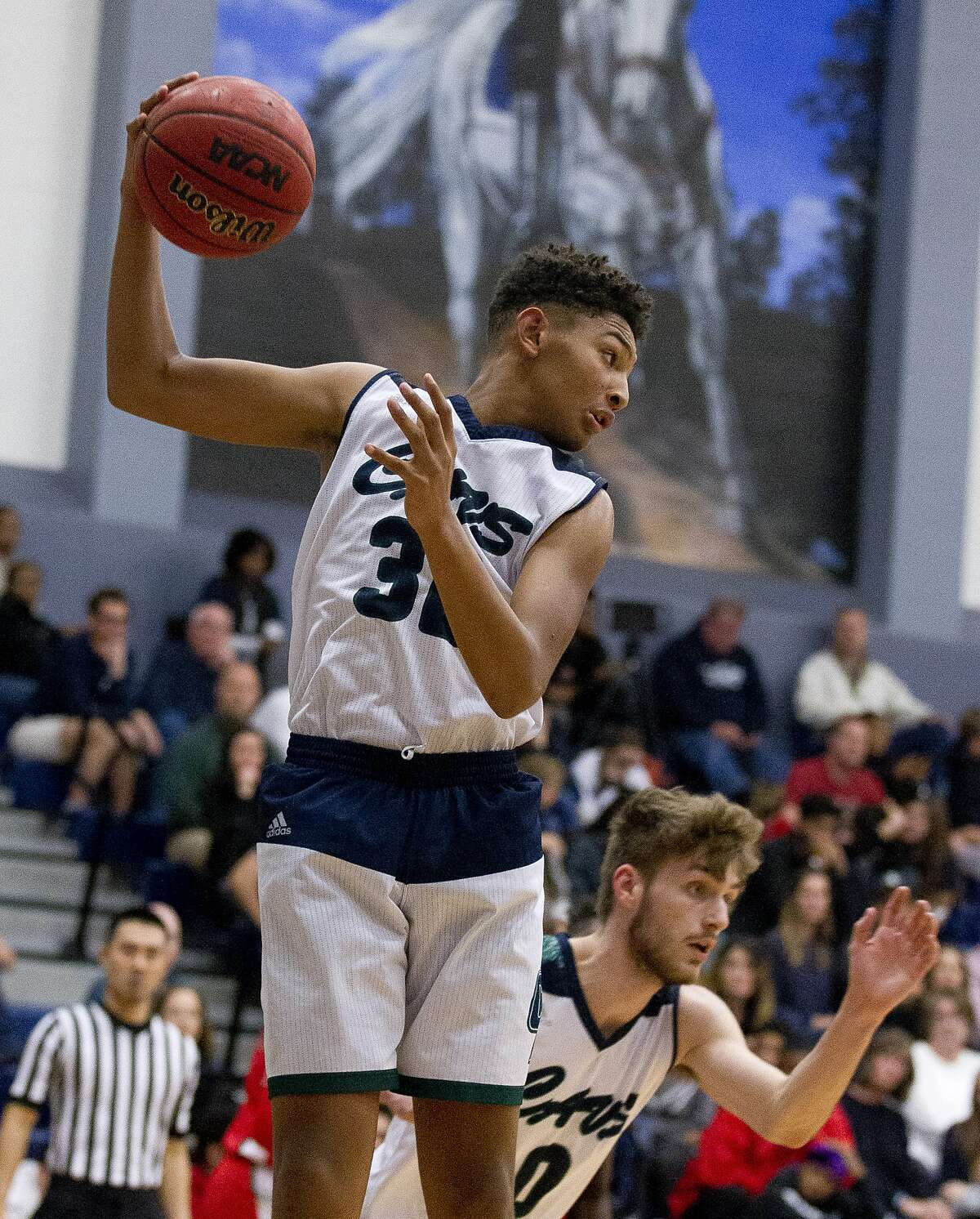 College Park guard Ty Buckmon (32) grabs a rebound during the third quarter of a District 15-6A high school basketball game at College Park High School, Friday, Jan. 11, 2019, in The Woodlands.