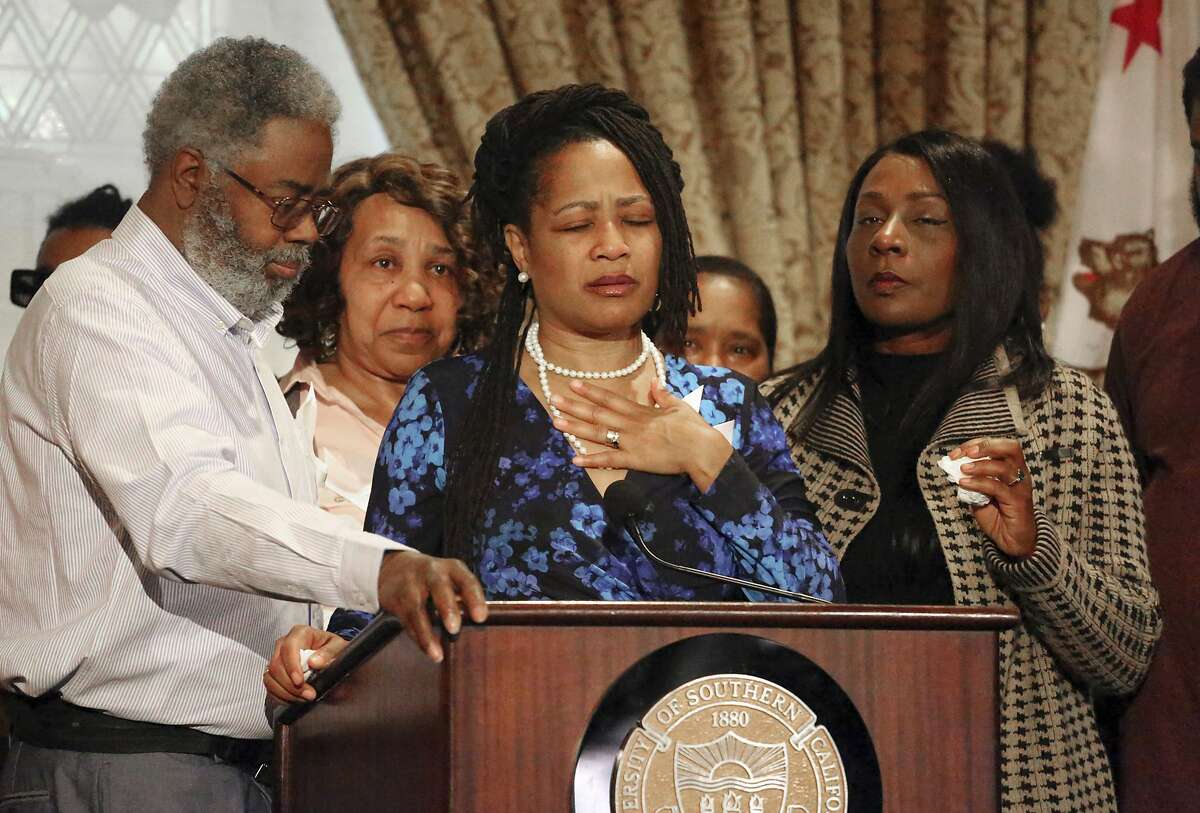 """Oakland City Councilwoman Lynette McElhaney, the mother of Victor McElhaney, 21, a University of Southern California student killed Sunday, March 10, 2019, during an attempted robbery, talks about her son during a news conference on the USC campus in Los Angeles Tuesday, March 12, 2019. She described her son's life from a high-risk pregnancy through an early talent for drumming to his start of classes at USC. """"Victor's not a homicide number or statistic, or just another black boy gunned down in South Central Los Angeles,"""" she said. """"I want you all to know that Victor came into the world a drummer. He was drumming from the moment he could sit up."""" Detectives were searching for three or four male suspects (AP Photo/Reed Saxon)"""