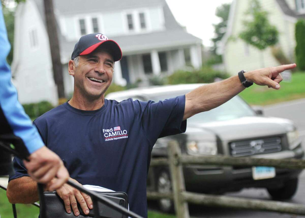 State Rep. Fred Camillo, R-Greenwich, canvasses in the Cos Cob section of Greenwich, Conn. Tuesday, Oct. 9, 2018. Incumbent State Rep. Camillo, representing District 151, is up for re-election against Democratic challenger Laura Kostin.