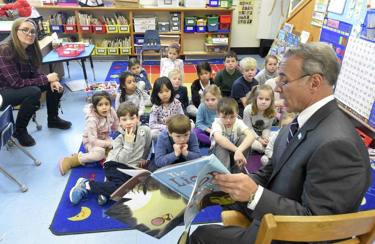 """State Representative Fred Camillo (R-CT 151st District) reads """"The Lion Inside"""" by Rachel Bright to Missy Gilson's first grade class during Old Greenwich School's 2nd annual World Read Aloud Day (WRAD) event on Friday, Feb. 1, 2019 in Greenwich, Connecticut."""