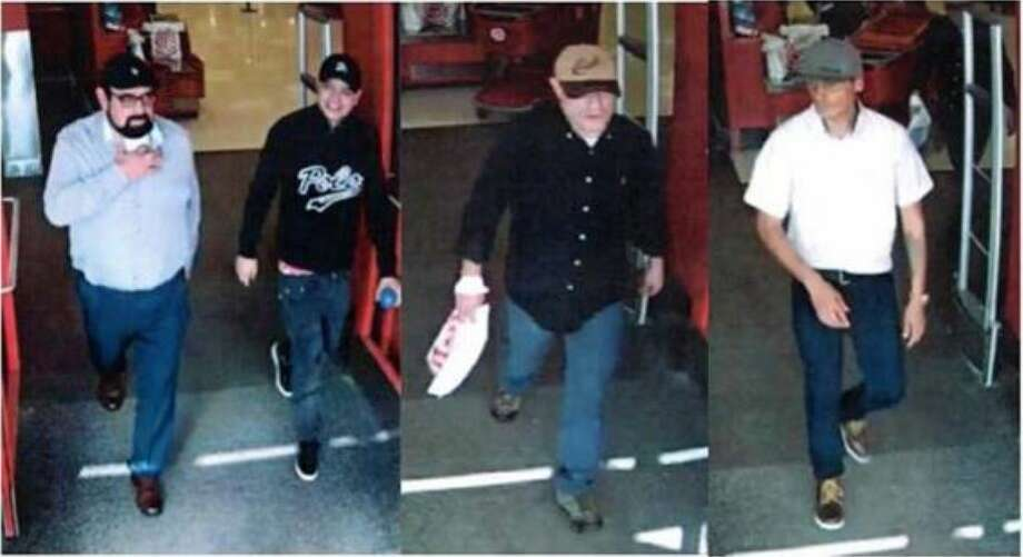 Four men are seen walking out of a Target store in The Woodlands where authorities say they made purchases using stolen credit and debit cards. Photo: Courtesy Of The Montgomery County Sheriff's Office