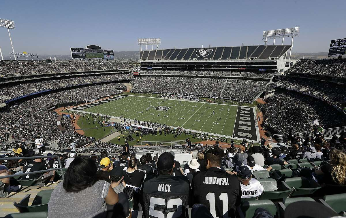 Fans watch during the first half of an NFL football game between the Oakland Raiders and the Baltimore Ravens in 2017.