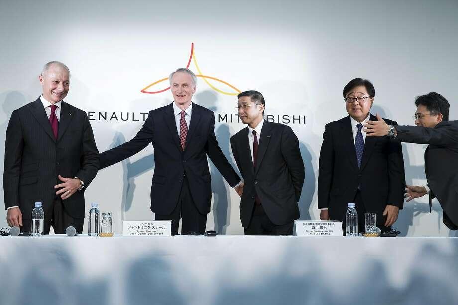 Renault CEO Thierry Bollore (left) and Chairman Jean- Dominique Senard join Nissan CEO Hiroto Saikawa and Mitsubishi CEO Osamu Masuko in Yokohama. Photo: Tomohiro Ohsumi / Getty Images