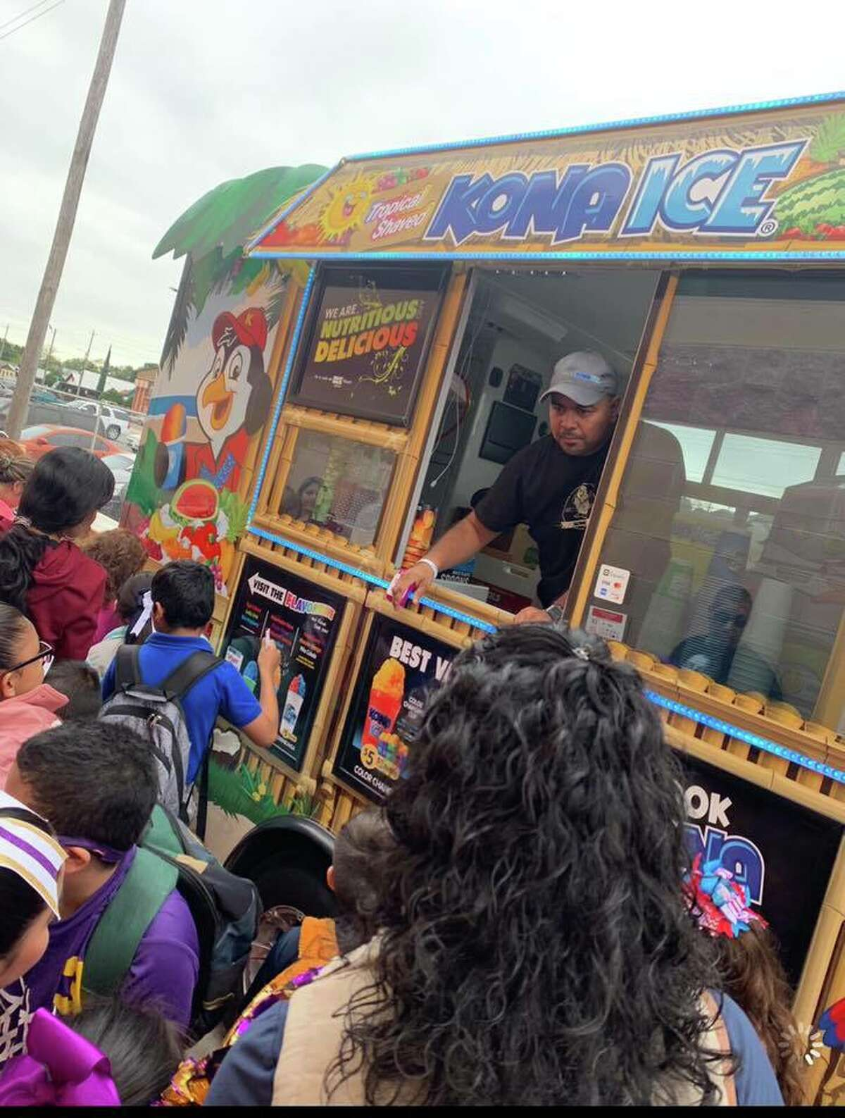 In this photo, Rene Gonzalez is shown. He is one of two local entrepreneurs who own a Kona Ice, a mobile franchise that gives back to the community through fundraising opportunities.