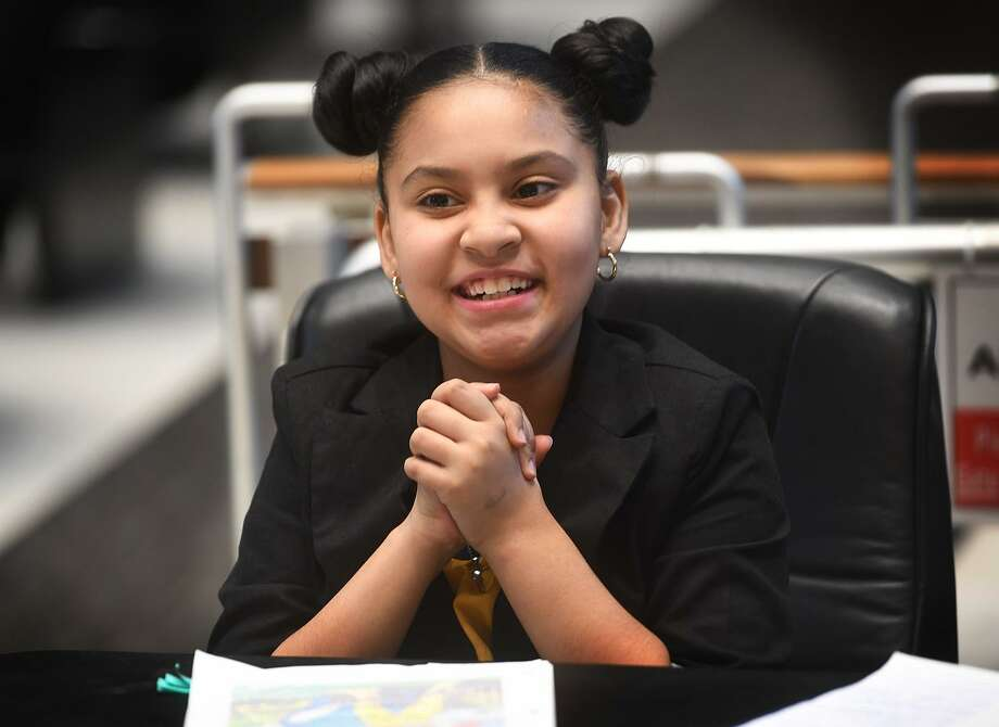 "Defense attorney for the day and fifth grader Carmella Bernini, 10, celebrates as the ""not guilty"" verdict is read in the case United States vs. Paul Bunyan during Hall Elementary School's annual mock trial at City Hall in Bridgeport, Conn. on Tuesday, March 12, 2019. Photo: Brian A. Pounds / Hearst Connecticut Media / Connecticut Post"