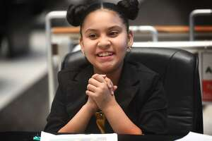 "Defense attorney for the day and fifth grader Carmella Bernini, 10, celebrates as the ""not guilty"" verdict is read in the case United States vs. Paul Bunyan during Hall Elementary School's annual mock trial at City Hall in Bridgeport, Conn. on Tuesday, March 12, 2019."