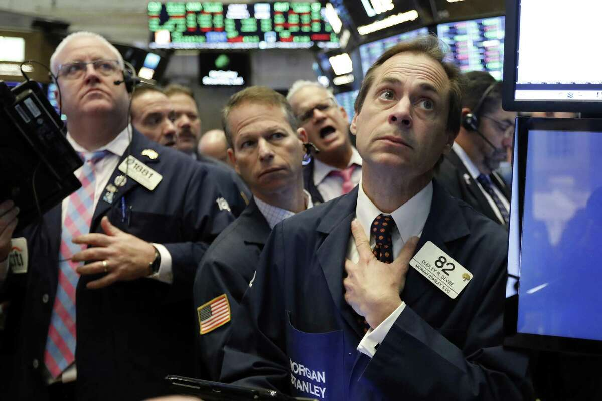 Dudley Devine, right, works with fellow traders on the floor of the New York Stock Exchange, Nov. 14. A reader says the U.S. should take advantage of markets and utilize them rather than turn away from them.