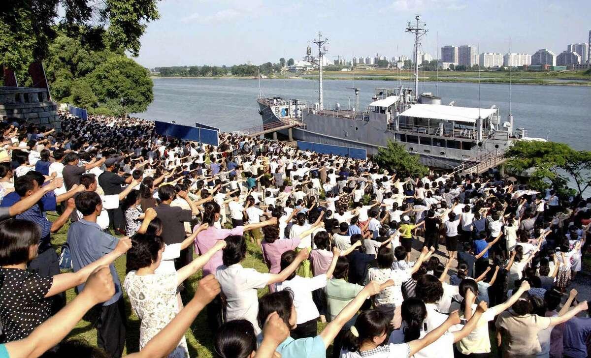 North Koreans rally in 2010 in Pyongyang, North Korea, in front of the U.S. Navy spy ship USS Pueblo, captured in 1968. A reader considers it a measure of U.S.-North Korean relations.
