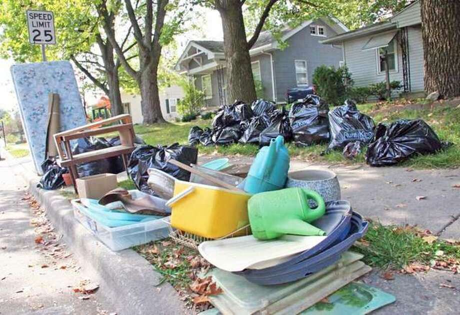 Trash sits curbside during a previous large item pickup week in Edwardsville. Photo: Intelligencer File Photo