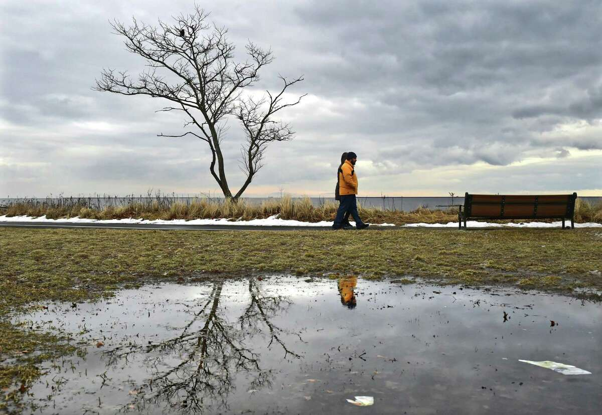 West Haven, Connecticut - Monday, February 18, 2019: Vladimir Shcheglov (CQ, of Brooklyn, and friend Anna Martin of North Haven take a seaside stroll Monday afternoon at Bradley Point Park in West Haven.