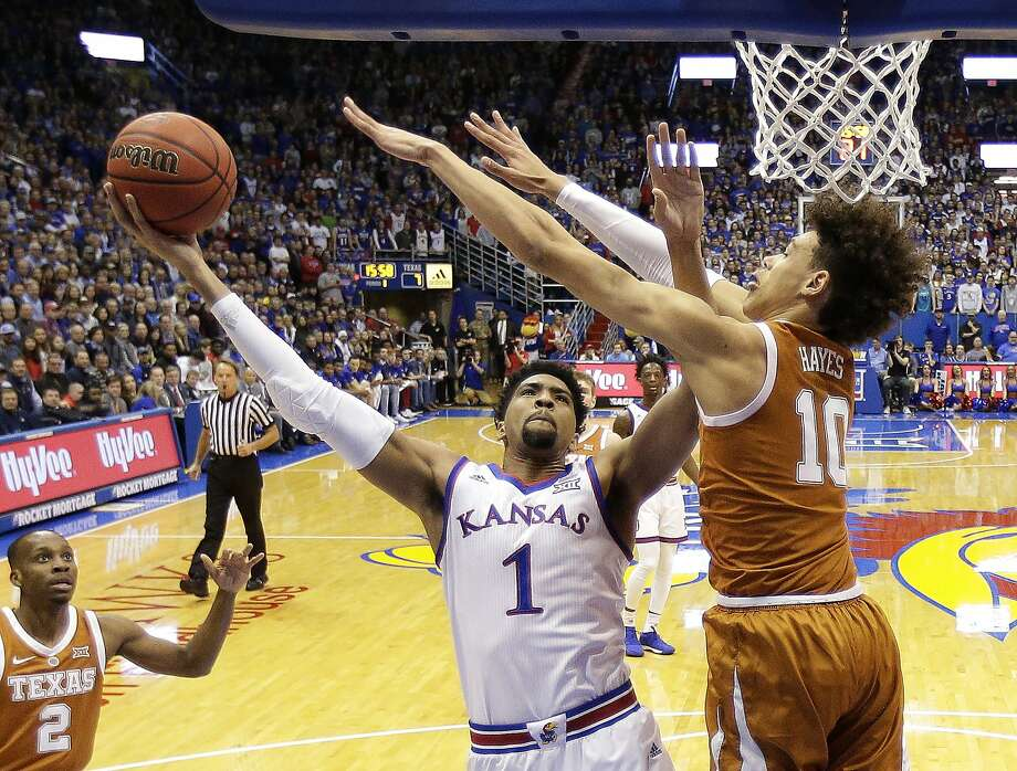 FILE - In this Jan. 14, 2019, file photo, Kansas forward Dedric Lawson (1) shoots under pressure from Texas forward Jaxson Hayes (10) during the first half of an NCAA college basketball game, in Lawrence, Kan. Lawson was named the Big 12 Conference Newcomer of the Year, Tuesday, March 12, 2019.(AP Photo/Charlie Riedel) Photo: Charlie Riedel, Associated Press