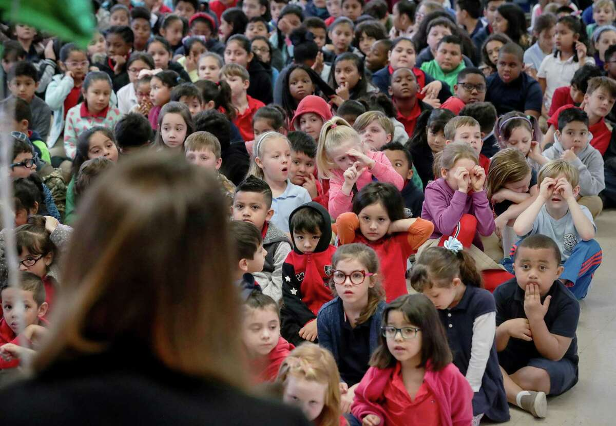 In this February 2019 file photo, Durham Elementary School students listen as their principal, Dr. Amy Poerschke, is recognized as HISD's elementary principal of the year.