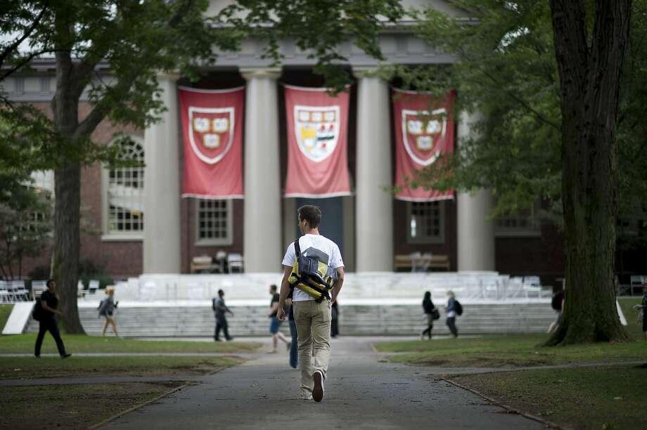 Harvard University students walk the school's campus in Cambridge, Mass. Photo: GRETCHEN ERTL / New York Times