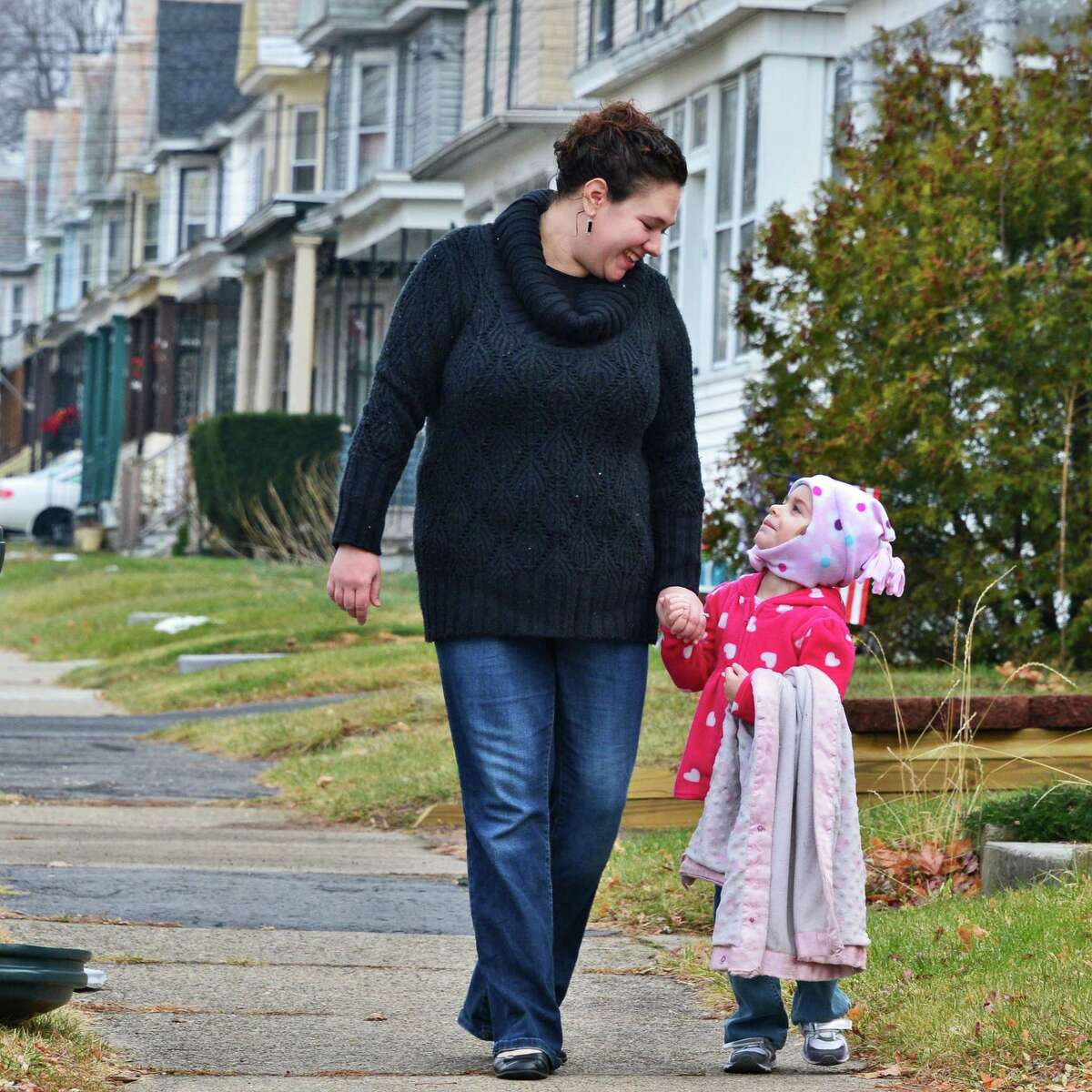 Julie Utter and daughter Chloe, 3, on the sidewalk outside their Snowden Avenue home in 2013, in Schenectady, NY. (John Carl D'Annibale / Times Union)