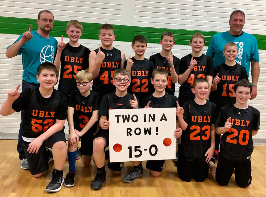 The Ubly sixth grade boys basketball team poses after finishing the season with a 15-0 record, winning the league and tournament championships. (Submitted Photo)