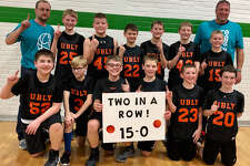 p.p1 {margin: 0.0px 0.0px 0.0px 0.0px; line-height: 10.8px; font: 10.0px Helvetica} The Ubly sixth grade boys basketball team poses after finishing the season with a 15-0 record, winning the league and tournament championships. (Submitted Photo)