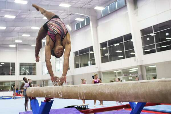 Gymnast Simone Biles practices during a work out on the high balance beam at the Wold Champions Centre, Friday, Nov. 9, 2018, in Spring.