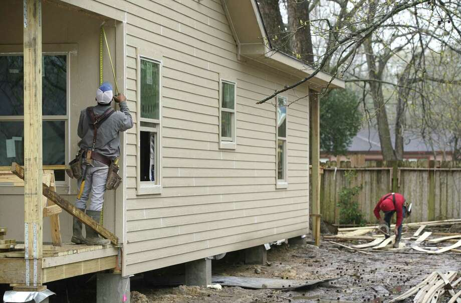 Builders are making plans for fewer single-family homes, according to numbers from the Department of Commerce released Thursday morning. Here, a home on McWilliams Drive in Acres Homes in Houston is shown under construction on Feb. 21, 2019. NEXT: New-construction homes in Houston's suburbs Photo: Melissa Phillip, Houston Chronicle / Staff Photographer / © 2019 Houston Chronicle