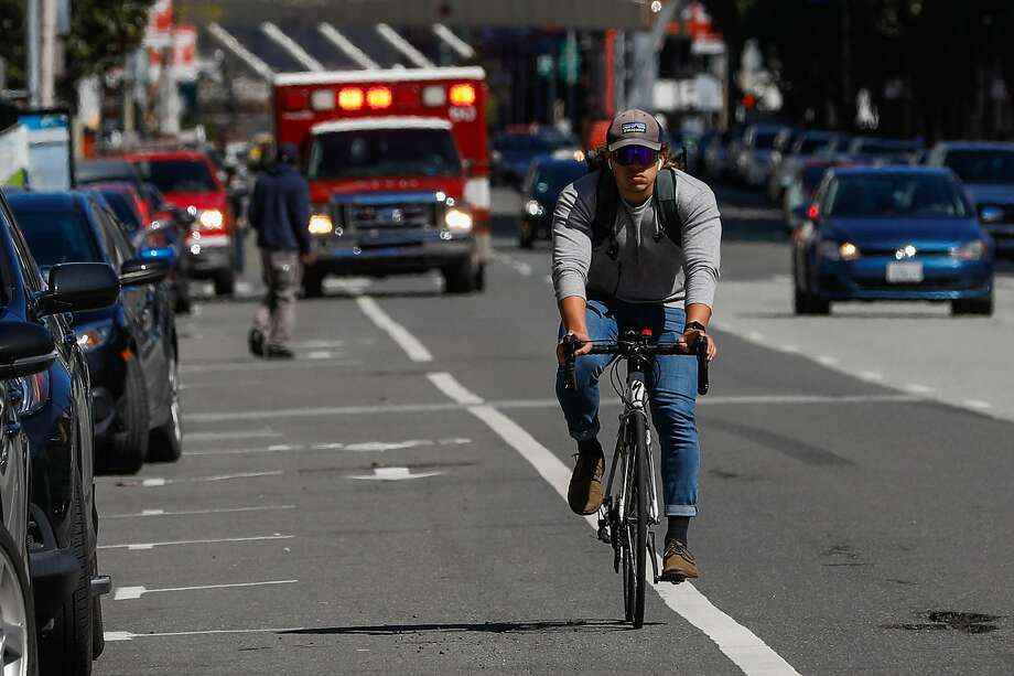 A biker rides on Howard Street where a cyclist was killed last Friday after being struck by a vehicle in San Francisco, California, on Monday, March 11, 2019 Photo: Gabrielle Lurie / The Chronicle