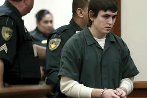 FILE - In this Feb. 25, 2019 file photo Dimitrios Pagourtzis, the Santa Fe High School student accused of killing 10 people in a May 18 shooting at the high school, is escorted by Galveston County Sheriff's Office deputies into the jury assembly room for a change of venue hearing at the Galveston County Courthouse in Galveston, Texas. A judge has ordered Pagourtzis' trial be moved to another county. State District Judge John Ellisor granted Pagourtzis' request for a venue change Wednesday, Feb. 28, 2019. (Jennifer Reynolds/The Galveston County Daily News via AP, Pool)