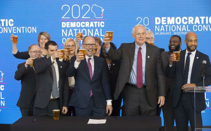 Democratic National Committee chairman Tom Perez, center, hoists a celebratory beer with Milwaukee Mayor Tom Barrett, right, and Milwaukee Bucks senior vice president Alex Lasry, left, following the official announcement March 11, 2019 that Milwaukee will host the 2020 Democratic National Convention. Perez chose Milwaukee over Houston and Miami.