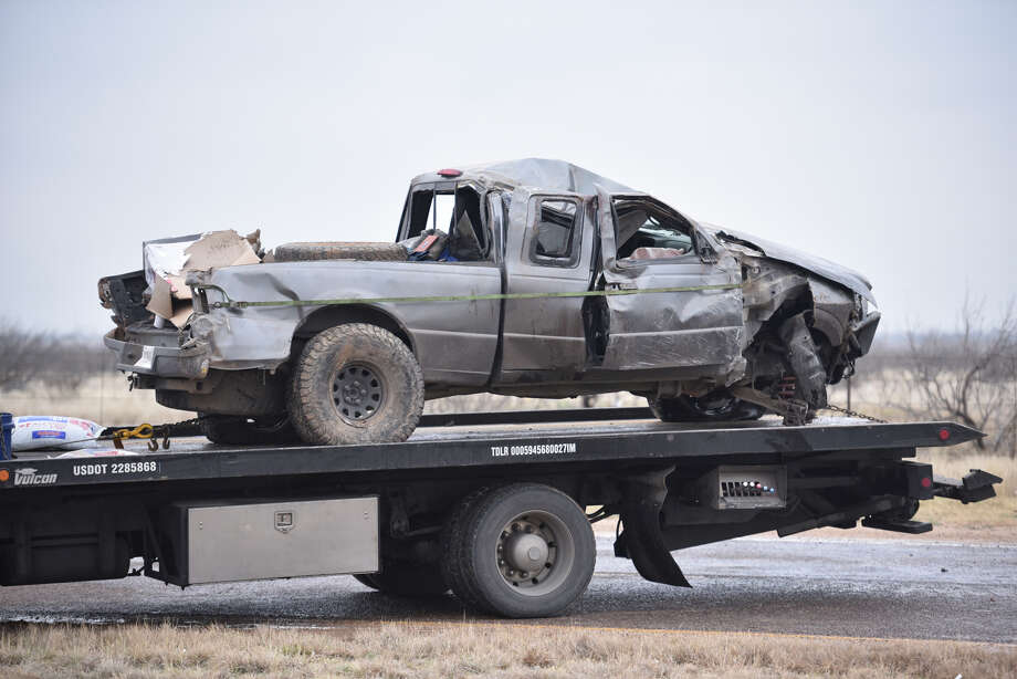 A truck is loaded onto a flatbed after a fatal accident on Highway 191 March 12, 2019. James Durbin / Reporter-Telegram Photo: James Durbin / Midland Reporter-Telegram / ? 2019 All Rights Reserved