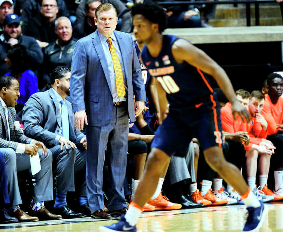 Illinois coach Brad Underwood's team will face Northwestern at 8 p.m. Wednesday in the first round of the Big 10 Tournament at the United Center in Chicago. Underwood, left, is shown during a game this season against Purdue. Photo: AP Photo