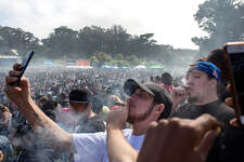 People take their selfies as they light up their joints after 4:20pm passed at the Hippie Hill 4/20 celebration in Golden Gate Park on Friday, April 20, 2018. San Francisco Calif. This is the first year when recreational marijuana use is legal in California.